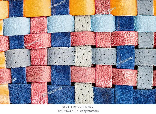 background from flat braided leather strips close up