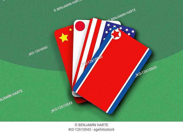 Chinese flag, Japanese flag, Stars and Stripes and North Korean flag as hand of cards