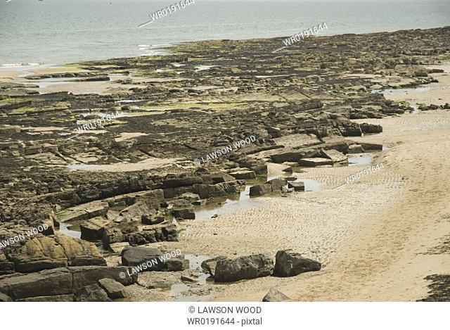 Rocky shoreline on North Northumberland Coast, England, UK North Sea