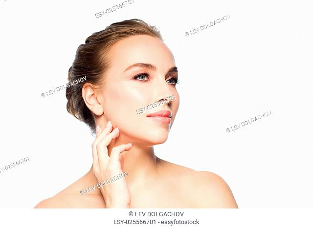 beauty, people and health concept - beautiful young woman touching her face and neck over white background