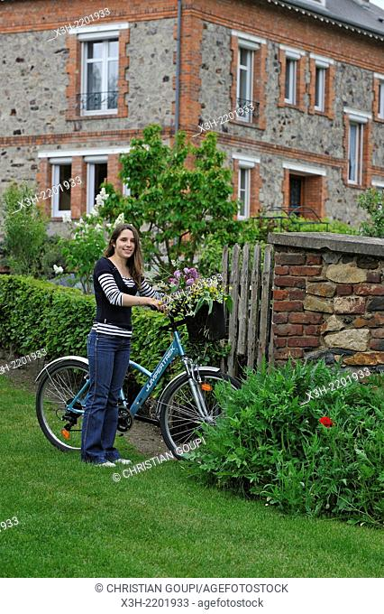 young woman with bicycle at Haybes, Ardennes department, Champagne-Ardenne region of northeasthern France, Europe