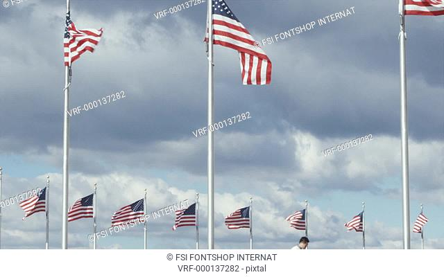CU of one man suspiciously passing a document another in front of American flags