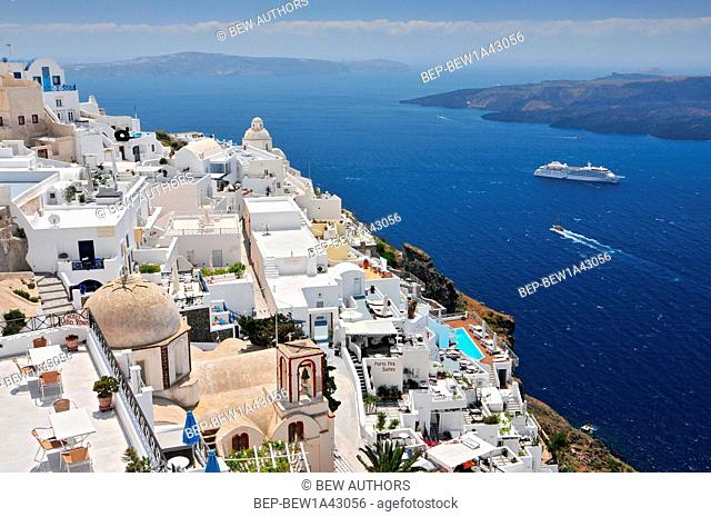 Afternoon view over town and ocean at Fira Thira Santorini Island Greece