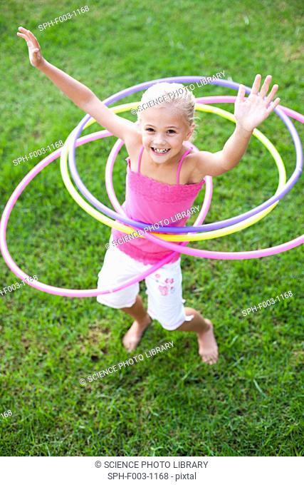 Young girl hula-hooping