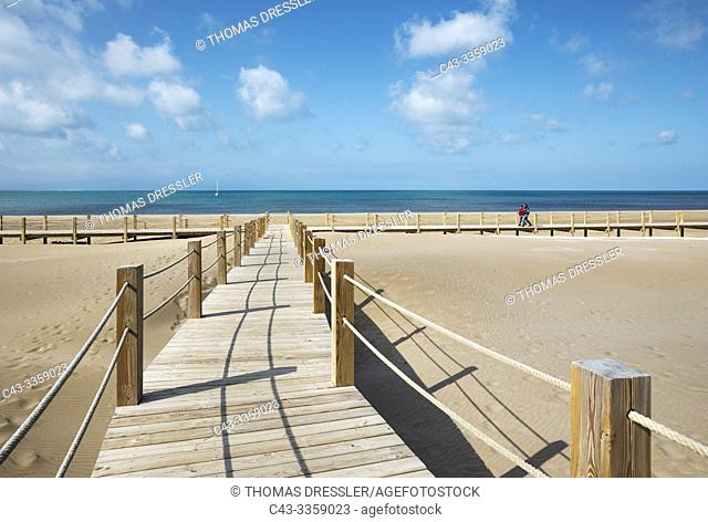 Wooden footbridges at the beach of Riumar. Environs of the Ebro Delta Nature Reserve, Tarragona province, Catalonia, Spain
