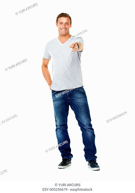 A casual man smiling and pointing at you while isolated on white