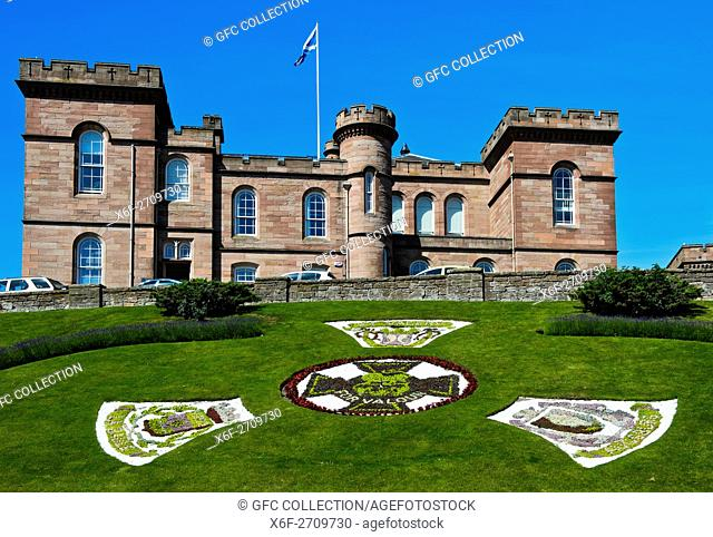 Inverness Castle with the Victoria Cross war medal as floral clock, Inverness, Scotland, Great Britain