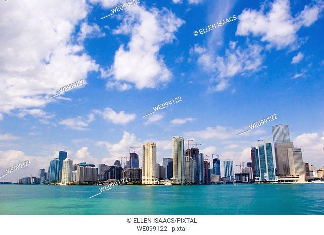 Skyscrapers of the downtown Miami skyline with Biscayne Bay and clouds in blue sky  Miami, Florida