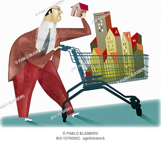 Businessman pushing shopping cart full of buildings