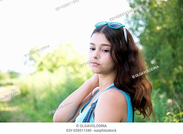 Girl teenager turned looking over a shoulder