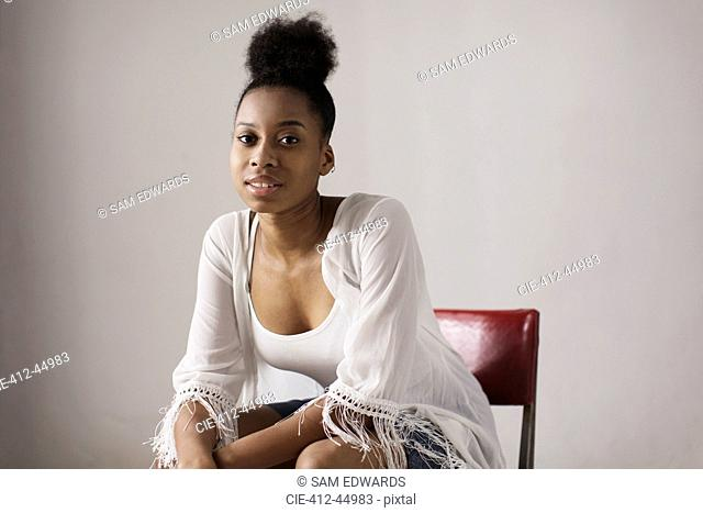 Portrait confident young woman