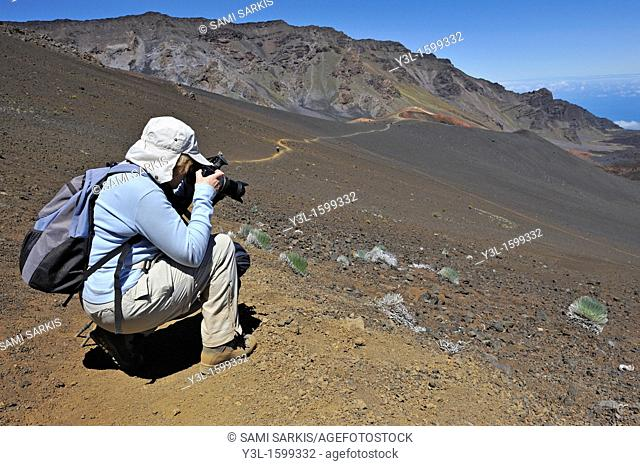 Senior woman taking photos during hike, Haleakala crater, Maui Island, Hawaii Islands, USA