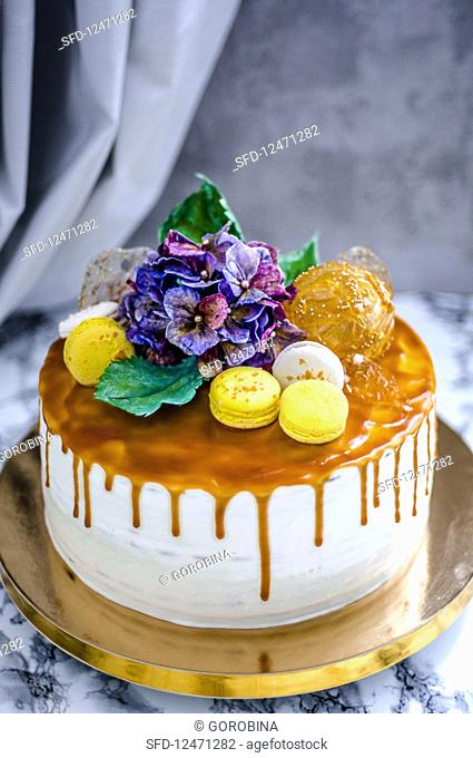 A festive cake with macaroons and flowers