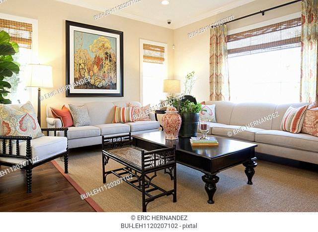 Seating furniture with large painting in a living room at home