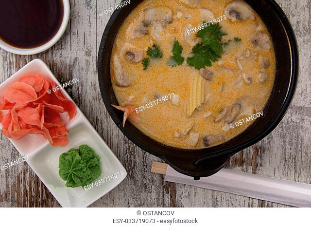 Tom Yum Goong spicy soup traditional food cuisine in Thailand on wooden background