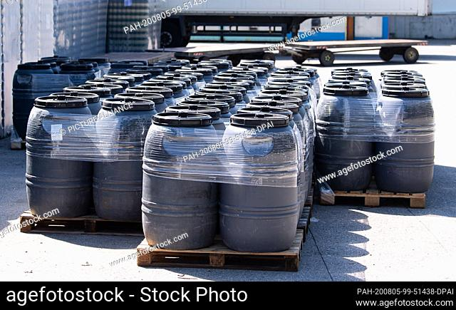 05 August 2020, Mamming: Barrels stand on the premises of a cannery where employees have been infected with the coronavirus