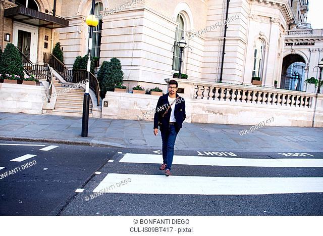 Businessman travelling in city, London, UK