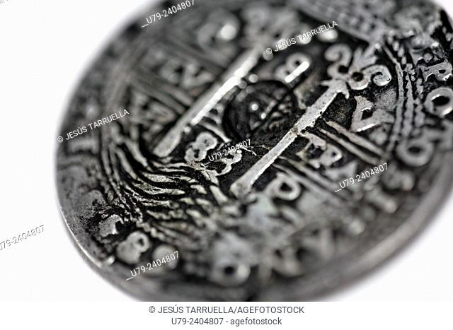 Still life of ancient coins. 8 Reales. Carlos III of Spain. The Peru. Potosí. 1683. Plus Ultra