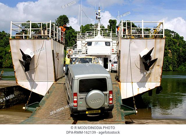 Loading of heavy vehicle on barge ferry boat ; Port Blair ; Andaman Nicobar Islands ; Bay of Bengal ; India October 2008