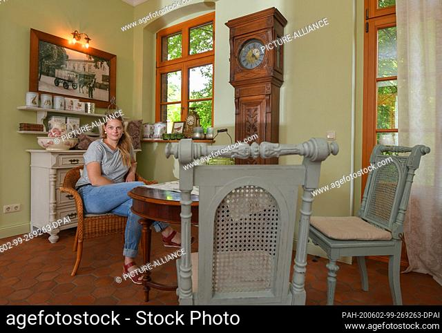 27 May 2020, Brandenburg, Biesenthal: Pamela John, operator of the Imperial Post Office, is sitting in her café. For 15 years Pamela John and her partner have...