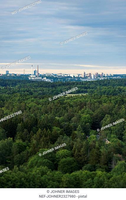 Aerial view of forest and industrial buildings