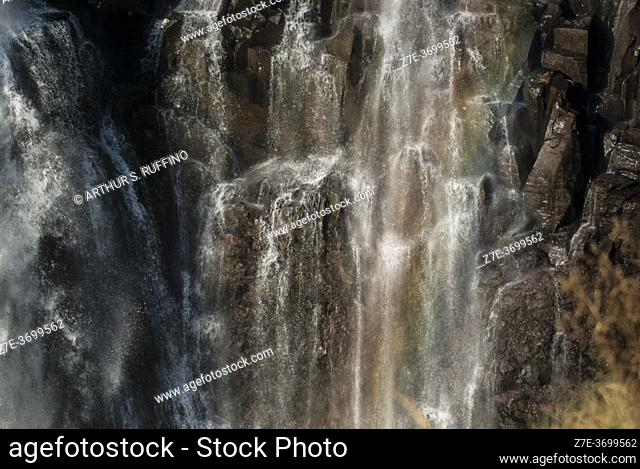 Soft rainbow light refraction over cataract. Eastern Cataract of Victoria Falls. Mosi-oa-Tunya National Park/Victoria Falls, Livingston, Zambia, Africa