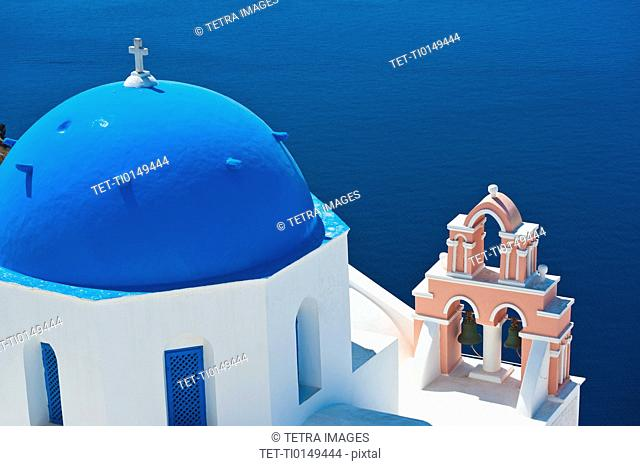 Greece, Cyclades Islands, Santorini, Oia, Church with bell tower by sea