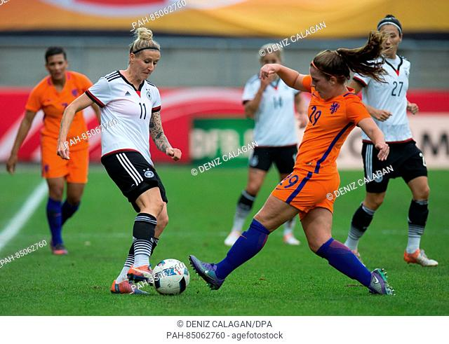 Germany's Anja Mittag (L) and the Netherland's Siri Worm vie for the ball during the women's international soccer match between Germany and the Netherlands in...