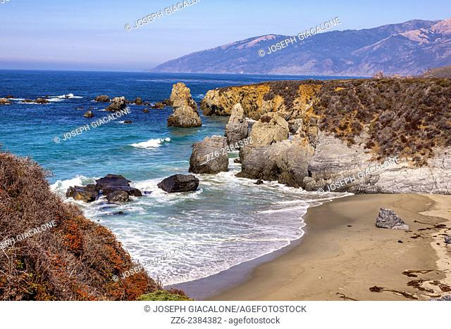 Looking down on a beach and rocky coastline. Big Sur, California, United States