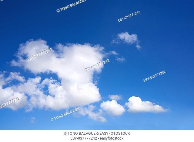 Blue sky summer white cumulus clouds background