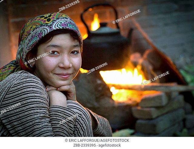 Young Uyghur Woman And Wood Stove, Kashgar, Xinjiang Uyghur Autonomous Region, China