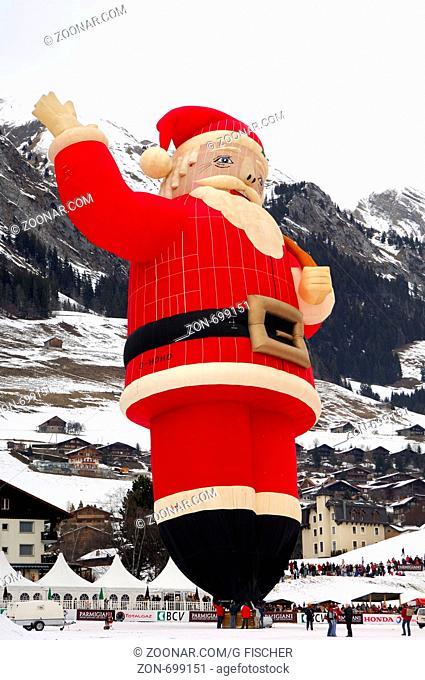 Heissluftballon Sonderform Weinnachtsman, Colt Santa-Claus SS, G-HOHO, auf dem Startplatz, Chateau d'Oex, Schweiz / Special shape hot air balloon Colt...