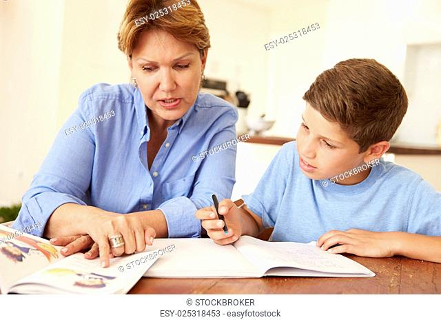 Grandmother Helping Grandson With Homework