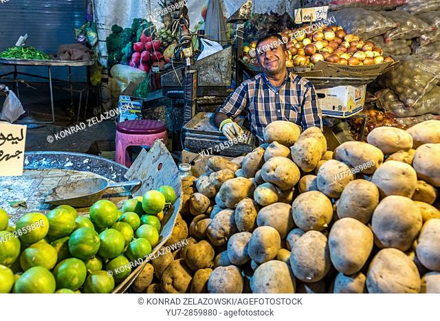 Iranian men selling vegetables on small market place in Shiraz city, capital of Fars Province in Iran