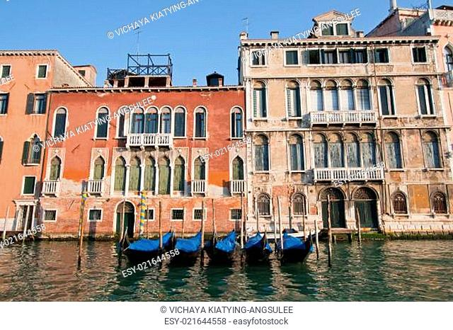 goldola boat parking in grand canal Venice Italy