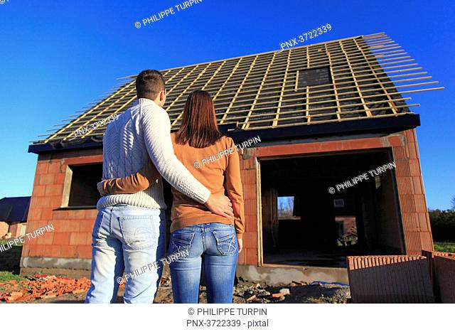 France, young person couples and house in construction