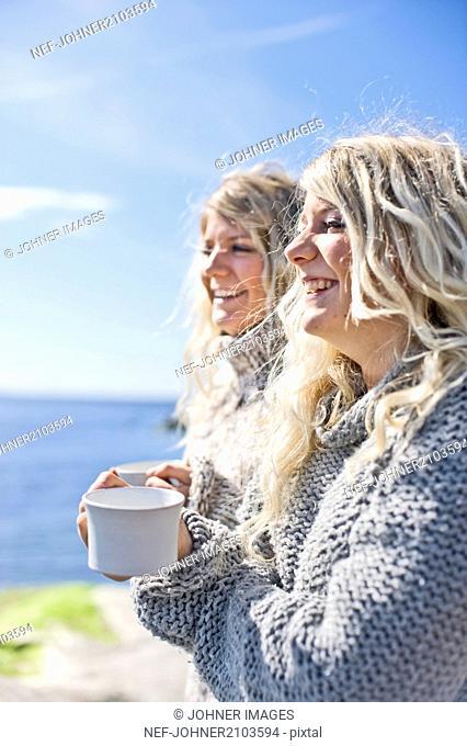 Smiling twins at seacoast