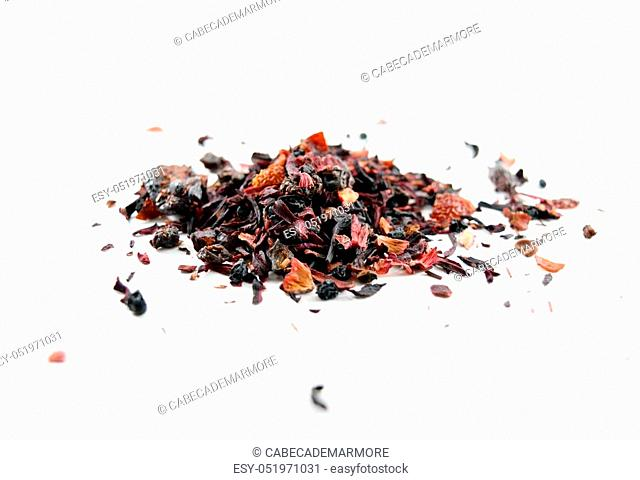 Heap of red berry herbal tea (tisane) with rooibos - isolated