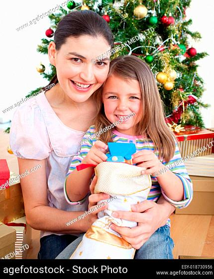 Mother and daughter at home at Christmas time