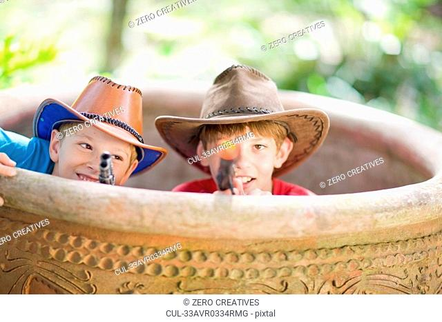 Boys playing in cowboy costumes