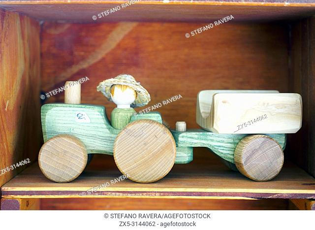 Wooden toy tractor for sale in a shop - Bruges, Belgium