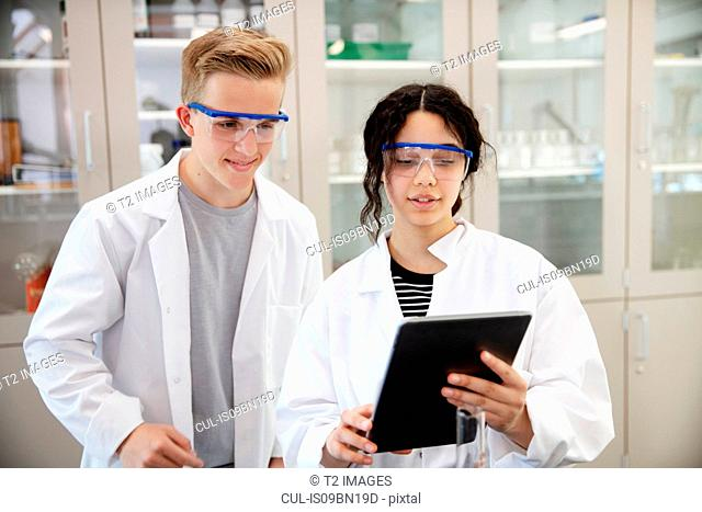 Students using digital tablet in laboratory
