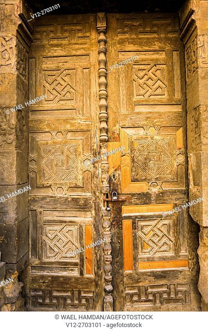 Wooden door of Bab Tekiah and dome of El- Kolchani Mosque, Dar El-Ahmar City of Cairo, Egypt