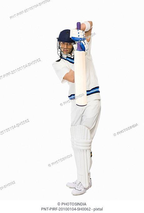Cricket batsman playing backward defensive stroke