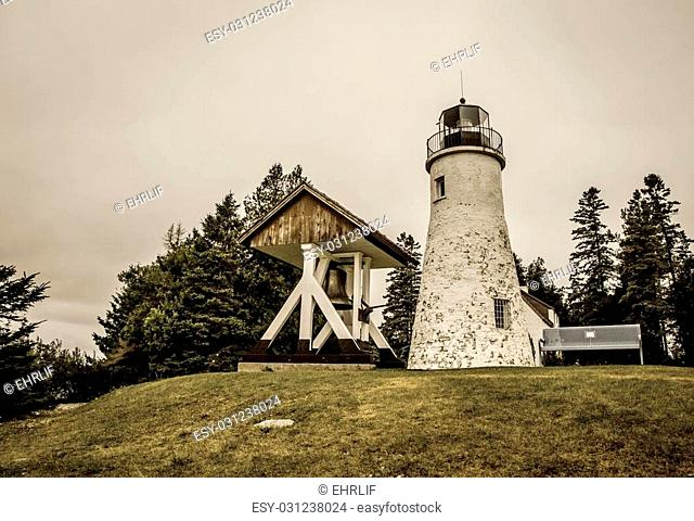 The old Presque Isle Lighthouse on the remote shores of Lake Huron. The lighthouse is supposedly haunted by a prior lightkeeper and currently operates as a...