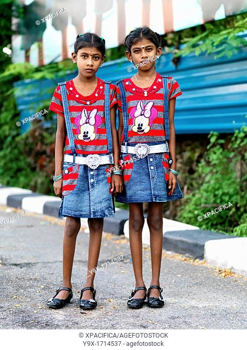 Indian Malaysian twins dressed in identical clothing