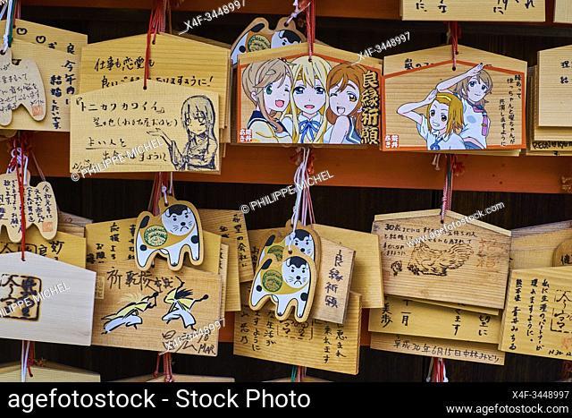 Japan, Honshu island, Kansai region, Kyoto, dog ex voto at Imamiya Jinja temple