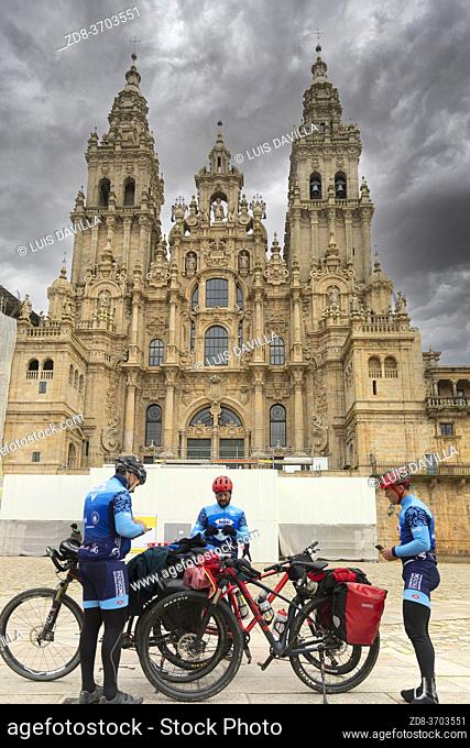 pilgrims of Camino de Santiago in the Cathedral in Obradoiro square. santiago de compostela. galicia. spain