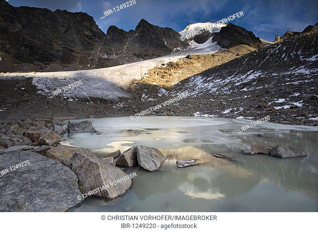 Mt. L'Angelo Grande reflected in a glacial lake, Stelvio National Park, South Tyrol, Italy, Europe