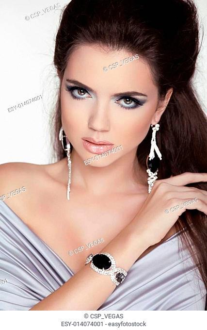 Beautiful woman with Trendy Fashion Jewelry Accessories. Make-up. Beauty Girl portrait. Professional studio photo